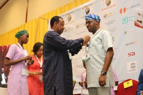 Awarding our Director with an Impact on Humanity Award from Oyo State